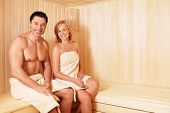 Young attractive couple in sauna