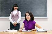 Two Students Near Blackboard