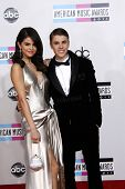 LOS ANGELES - NOV 20: Justin Bieber; Selena Gomez at the 2011 American Music Awards held at Nokia Th