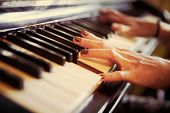 Closeup Of Antique Piano Keys And Wood Grain. Musician Hands Playing Piano On Piano Keyboard.low Key poster