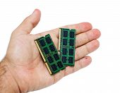 Hand With Laptop Memory Modules