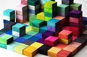 Spectrum of stacked multi-colored wooden blocks. Background or cover for something creative, diverse poster