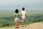 Kids Holding Hands On The Hill Panorama. Kids Looking On Panorama From Mountain Peak. Kids Holding H poster
