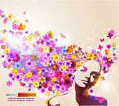 foto of beautiful face  - Portrait of beautiful young woman in sensual state covered with flowers - JPG