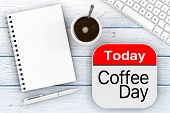 Today Is Coffee Day Icon, Blank Note Pad With Penб Computer Keyboard And Cup Of Coffee On A Wooden T poster