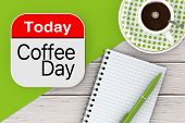 Today Is Coffee Day Icon, Blank Note Pad With Pen And Cup Of Coffee On A Wooden Table. 3d Rendering poster