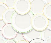Seamless background of White plates set with colorful rims