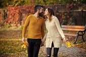 Autumn Happy Couple Of Girl And Man Outdoor. Nature Season And Fall Holiday. Love Relationship And R poster