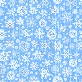 Blue seamless christmas background of flakes