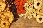 image of dry fruit  - Various dried fruit displayed on an old wooden table  - JPG