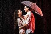 Side View Of Romantic Couple In White Shirts With Umbrella Standing Under Rain On Black Backdrop poster