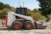foto of bobcat  - an small excavator Bobcat at construction site - JPG