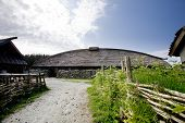 stock photo of longhouse  - An old norwegian viking farm with a long house - JPG