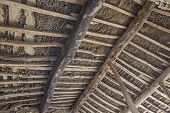 stock photo of tithe  - Antique wooden roof with main beam and joist - JPG