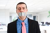 foto of tyranny  - Portrait of a businessman having the mouth closed with tape - JPG