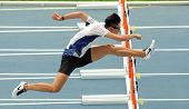 BARCELONA - JULY, 10: Ching Yeung Mui of Hong Kong warming up before 110 meters hurdles of the 20th