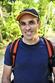 stock photo of portrait middle-aged man  - Portrait of happy middle aged man on a forest trail - JPG