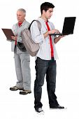 Electrician with a clipboard and young man with a laptop