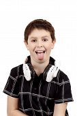 Young Boy Grinning And Show Tongue With Headphones