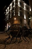 Metal chairs on during night in front of the restaurant