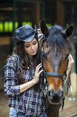 stock photo of cowboy  - A friendship between cowboy girl and horse at the ranch - JPG