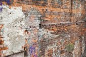 old brick wall texture with graffiti