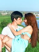 Summer Outdoors Portrait Of Young Sensual Couple