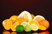foto of pamelo  - Lots ripe citrus on dark color background - JPG