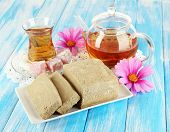 picture of sugar paste  - Tasty halva with tea on table - JPG