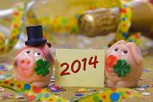 stock photo of talisman  - pig with clover leaf as talisman for new year 2014 - JPG