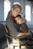 Beautiful blonde woman and her little son together