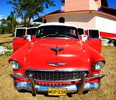 A Classic Old Car Is Red Color