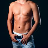 picture of pectorals  - Sunburnt muscular male torso in the jeans - JPG