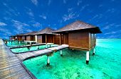 stock photo of beach hut  - Amazing water villa in beautiful beach in Maldives - JPG
