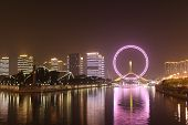 Night view of Tianjin eye ferris wheel