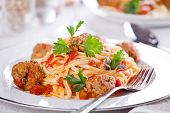 stock photo of meatball  - Close up photograph of a tasty meal of pasta with meatballs - JPG