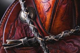 stock photo of western saddle  - horse saddle leather and various equipment on background - JPG