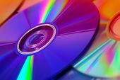 background of some colorful compact discs