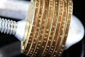 Budget Crisis US Currency Gold Coins in Vise Clamp