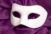 White theatrical mask and silk fabric