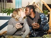 Kissing Happy Couple: Black Man And White Woman With Glass Of Wine At Party