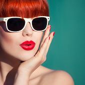 stock photo of lipstick  - Colorful summer portrait of an attractive young woman with sunglasses - JPG