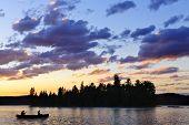 Canoe On Lake At Sunset