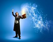 Image of magician holding hat with lights and fumes going out