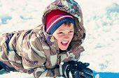 Cute Boy Eating The Snow