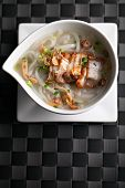 foto of crispy rice  - Closeup top down view of Thai style crispy pork rice noodle soup in a bowl with copy space - JPG