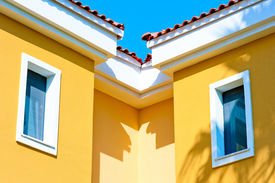 stock photo of gabled dormer window  - two small windows in the attic under the roof - JPG