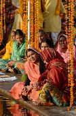 senior women perform puja - ritual ceremony at holy Pushkar town,Rajasthan