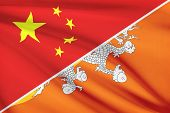 Series Of Ruffled Flags. China And Kingdom Of Bhutan.