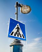 stock photo of street-walker  - Frozen road sign for pedestrians with the street lamp above - JPG